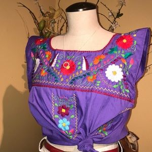 Embroidered purple crop top.